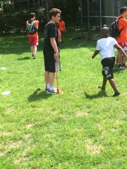 BYS Golf Coach, Max Bunzel, works with kids at White Plains Youth Bureau Camp