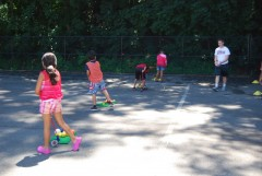 Third graders playing golf and handball