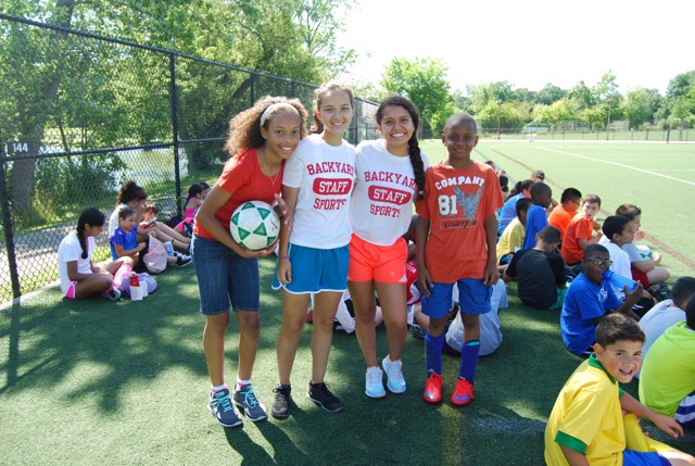 Fun Backyard Sports : Backyard Sports Coaches with Campers from left Megan Ramos and Nicole