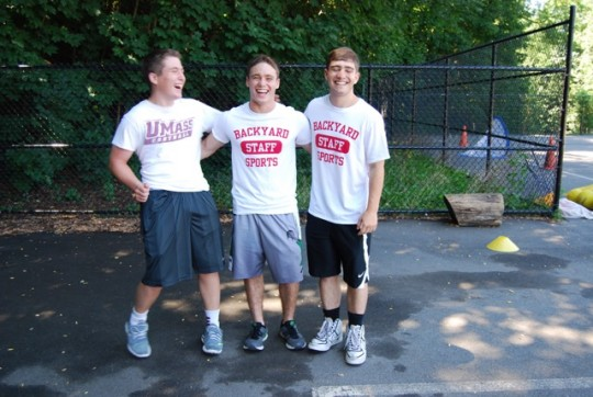 Coaches Max Bunzel (left), Elliot Graham (middle), and Shane Wolfe (right) having a candid moment before camp starts