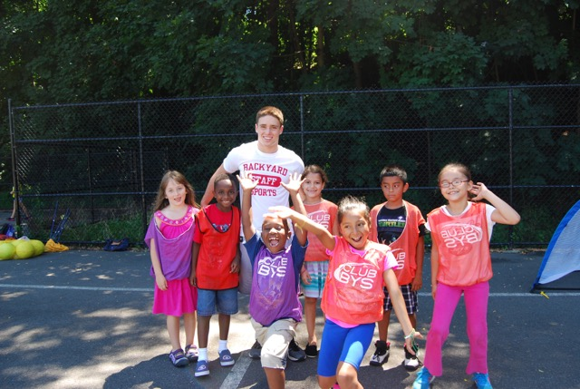 Elliot Graham with campers after and during a game of hand ball!