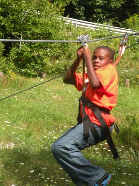 Rocking the zipline at Brant Lake Summer Camp