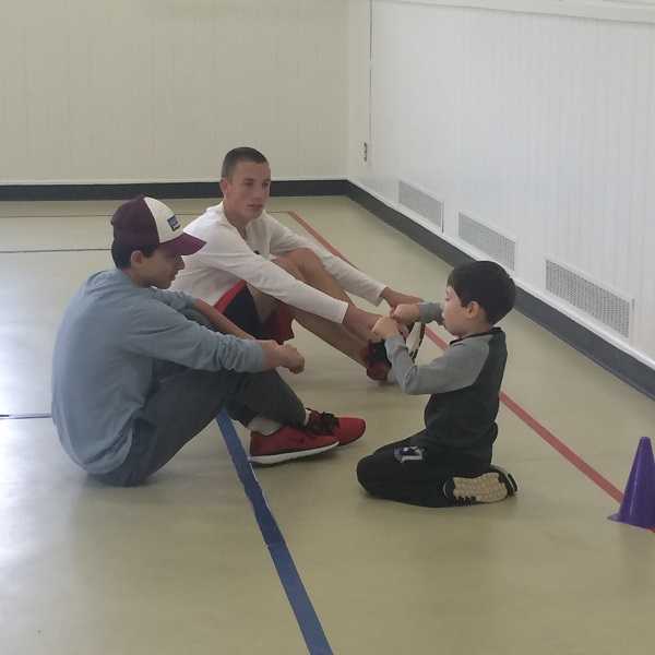 BYSC teen coaches with children from new special needs program in Weston, CT